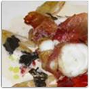 Lotte, un tronçon meunière en robe de jambon cru, feuille de romaine, une sauce créme a la truffe.